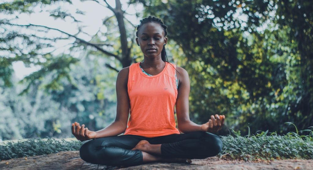woman meditating 6 apps to destress
